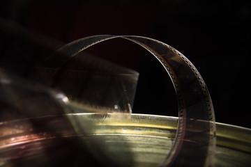 Old film with movie on a dark background
