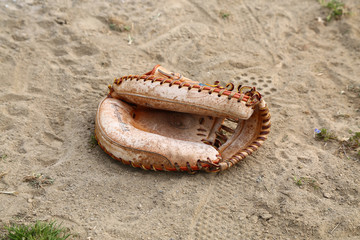 Old Catcher's Mitt on the Ground