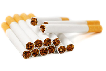 closeup of cigarettes isolated on white background