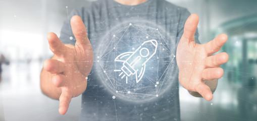 Businessman holding a  start up rocket on a sphere 3d rendering