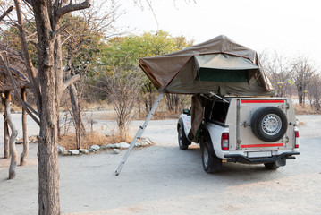 Offroad 4x4 vehicle with tent in the roof