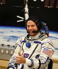 International Space Station (ISS) crew member and astronaut Nick Hague of the U.S. gestures after donning a space suit shortly before a launch at the Baikonur Cosmodrome
