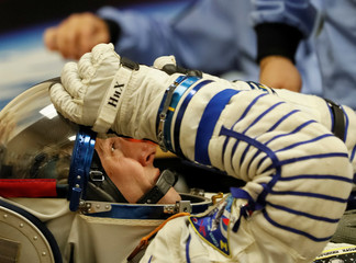 International Space Station (ISS) crew member and astronaut Nick Hague of the U.S. looks on during his space suit check shortly before a launch at the Baikonur Cosmodrome