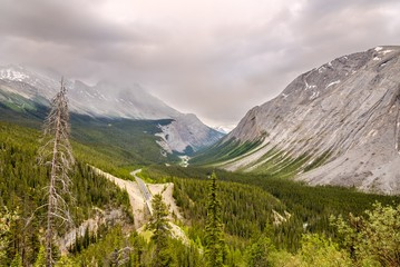 Wall Mural - Icefields Parkway road between mountain massifs of Canadian Rocky Mountains.