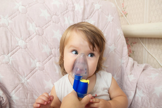 sick baby girl use nebulizer mask for inhalation, respiratory procedure by pneumonia or cough for child, inhaler, compressor nebulizer, nebules machine for health care