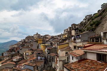 View of Motta Camastra from Corso Umberto. Motta Camastra is  a village in Sicily not far from Taormina, perched on the top of a hill in the valley of the Alcantara River