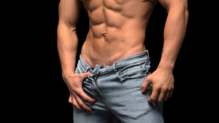 Man is blue jeans showing his muscular abs and body.