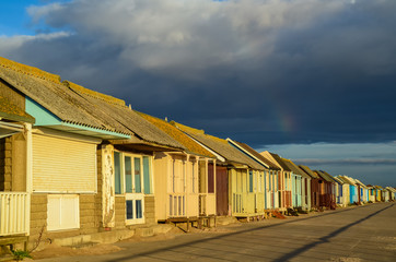 Beach Huts at Sutton on Sea with stormy sky