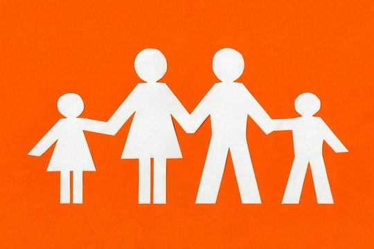 happy paper family on a bright orange background.