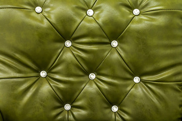 Green leather sofa texture background.