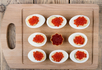 Red caviar on hard boiled chicken eggs.