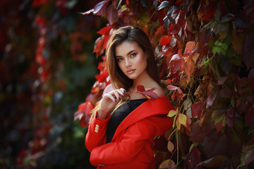 Young female brunette model in autumn park