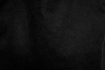 Crumpled black fabric texture background. Detail of dark textile.