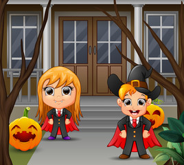 A vampire couple with yellow hair standing in front of the house