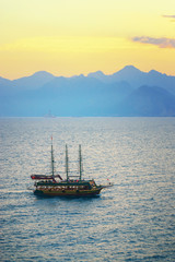 Touristic Pirate ship in the bay of Antalya at sunset, Turkey