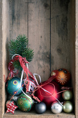 Christmas decoration glass balls in a wooden box background