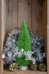 Christmas decoration pinecone and tree in a wooden box background