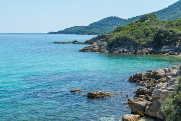 Turquoise Seawater surface and beach in Greece