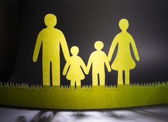 the family of colored paper on a dark background.