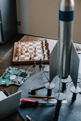 chess board and rocket model on table in living room