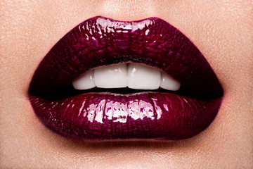 Foto op Plexiglas Fashion Lips Beautiful female with red shiny lips close up, like a cherry
