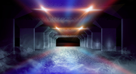 Dark corridor of the underground garage, street exterior, neon light. Abstract dark background of street asphalt with smoke, rays of searchlights in tunnels