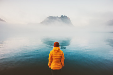 Woman looking at foggy sea