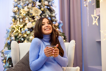 pregnancy, drinks, winter, people and expectation concept - happy pregnant woman with cup drinking tea at home