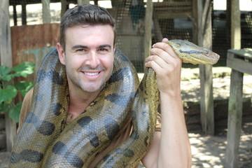 Man with a giant Anaconda around his neck