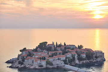 The island of Sveti Stefan. The Resort Of Montenegro. Sunset on the island of Sveti Stefan.