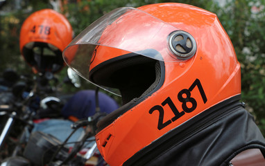 SafeBoda helmets are seen on motorcycle taxis known as boda-boda, in Kampala