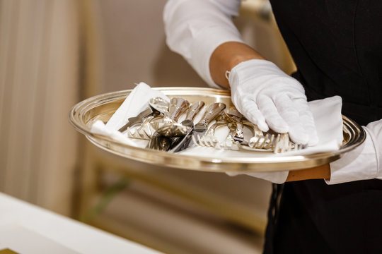 Close-up of restaurant staff setting table for reception
