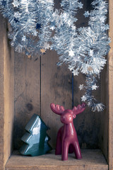 Christmas decoration deer and tree figure in a wooden box background