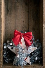 Christmas decoration wooden star in a wooden box background