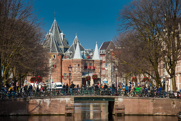 The beautiful canals of Amsterdam, the bicycles and the Waag a 15th-century building located at Nieuwmarkt square