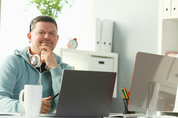 Handsome smiling male student using online