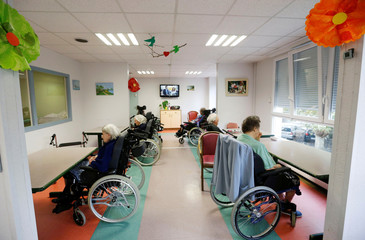 An elderly people rest on their wheelchairs in an EHPAD (establishment for the housing of Elderly Dependant People) in Bordeaux