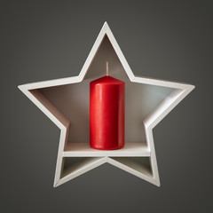 Christmas decoration white star with red candle inside