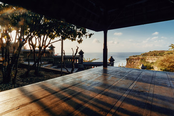 Resting hut at Uluwatu Cliff on sunset.