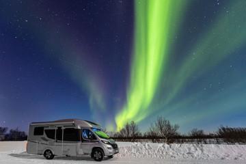 Winter camper trip under Northern Lights