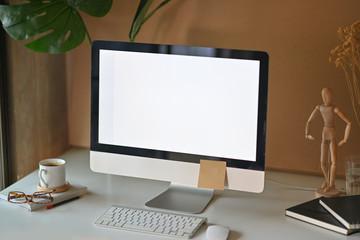 Loft space with modern desktop computer and supplies