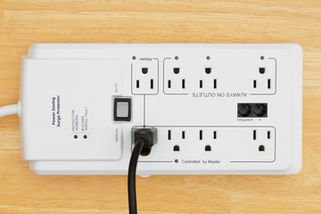 A power surge protector on wood