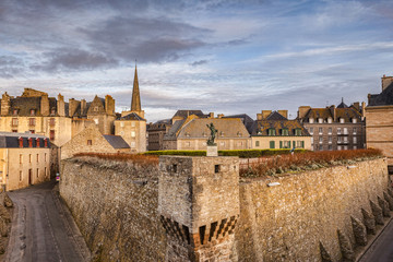 A view within the walls of Saint-Malo, with the statue of Robert Surcouf, a famous pirate of the town. Brittany, France.