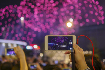 Holiday, colorful sky, fireworks shoots on smartphone