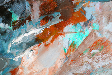 Blending with a palette knife of multicolor paint on the canvas