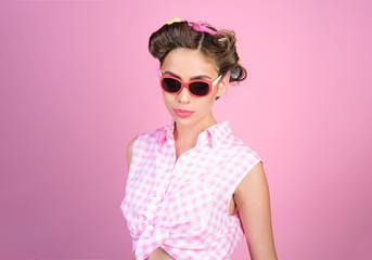 Pin up girl. happy girl in summer glasses. vintage housewife woman make hairstyle. retro woman with fashion makeup. beauty salon and hairdresser. Ambitious and beautiful. Perfect female