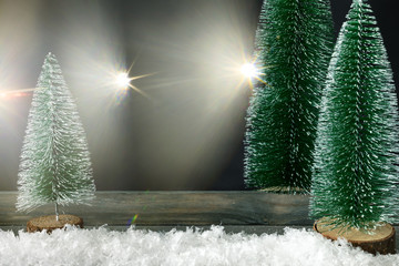 Christmas decoration background with fir trees and light flares