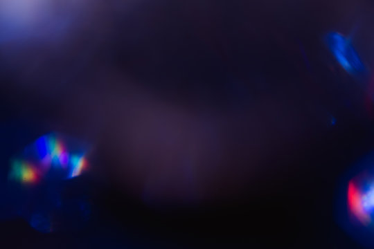 lens flare colorful abstract light glow. optical flash spotslight background.