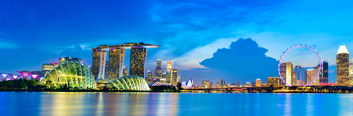 Vibrant color panorama background of Singapore skyline view of skyscrapers on Marina Bay