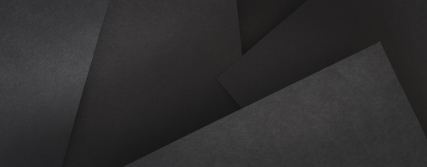 paper layers. abstract geometric background with copy space. black sheets collage.